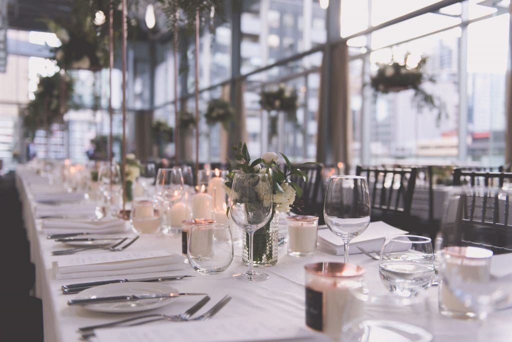 Wine glasses, candles and flowers adorn a wedding table at alto GPO in Melbourne