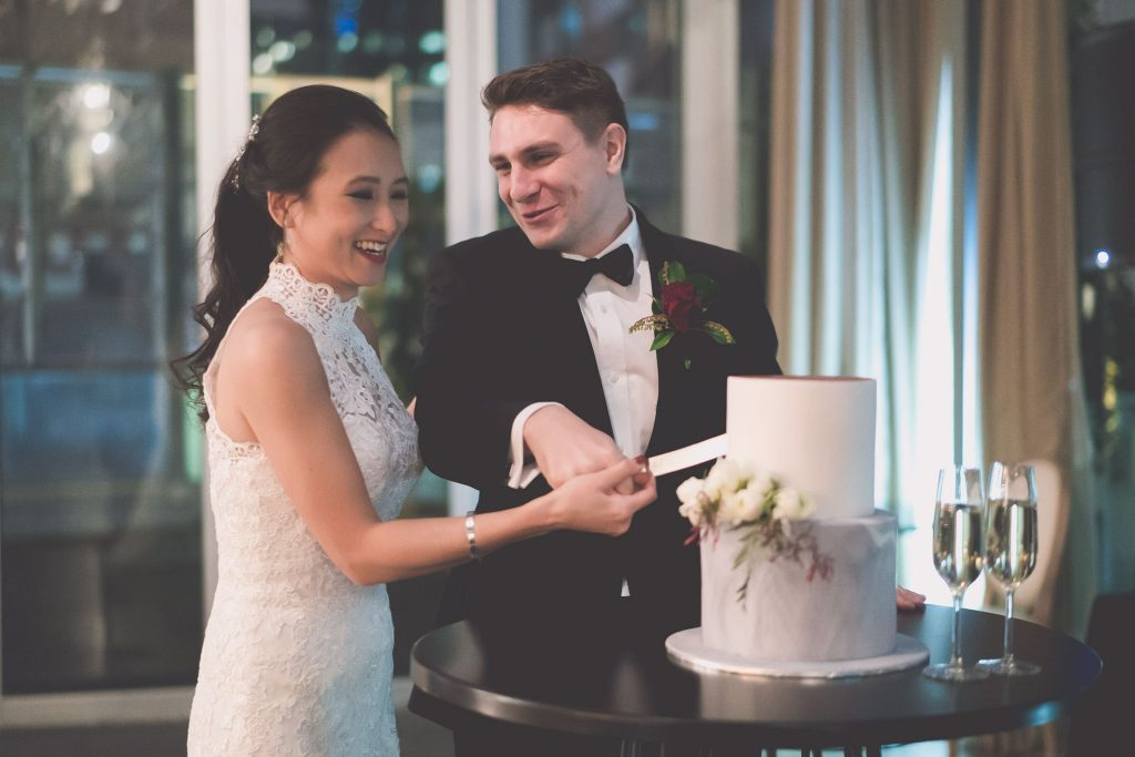 The bride and groom cut the cake at their Melbourne GPO wedding