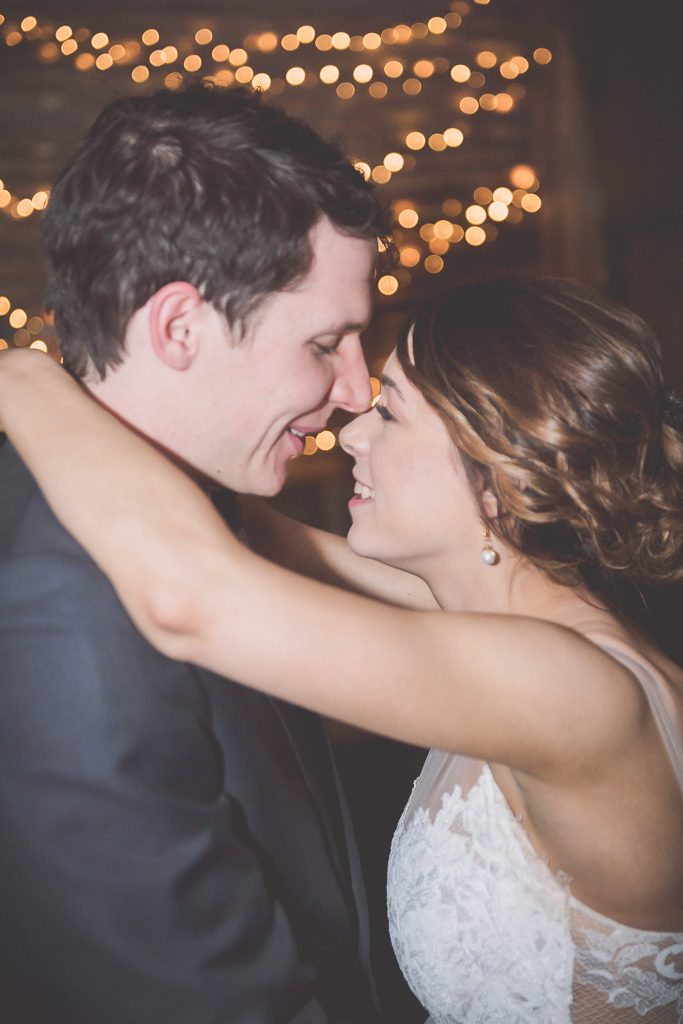 A slow first dance between a bride and groom.