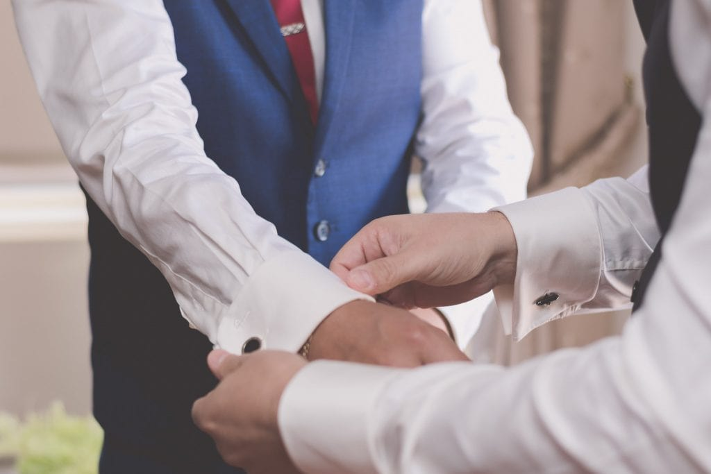 Cufflinks can be tricky on your wedding day. Brighton Wedding photography by Pause The Moment