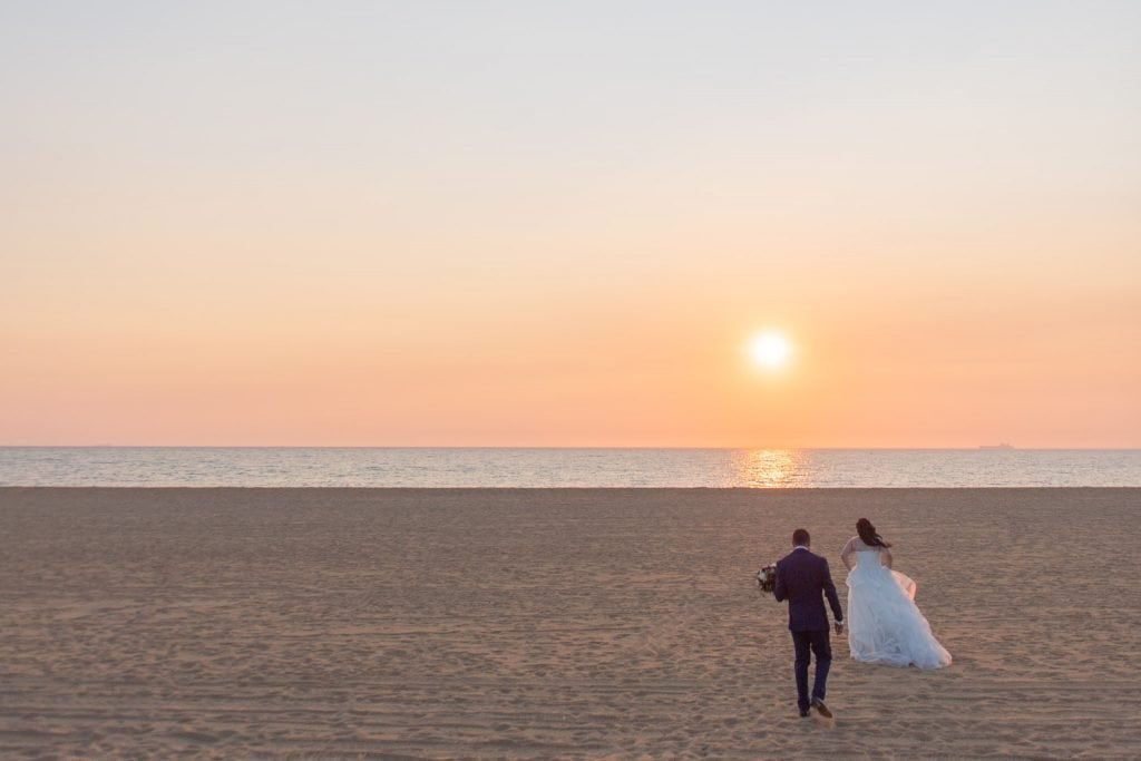 Lynette and Ayhan walk towards the beach for another wedding photography portrait session in Brighton.