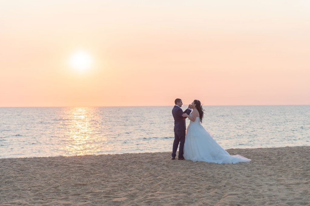 A newly married couple play while their wedding photography happens